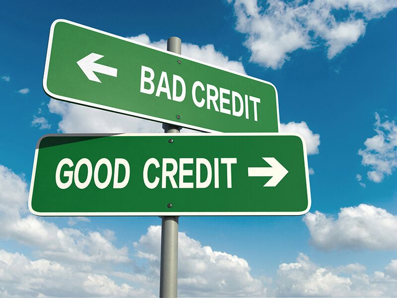 """street sign with arrows pointing to """"good credit"""" and """"bad credit"""""""