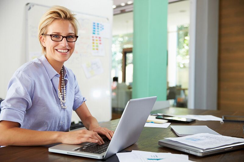 self-employed business owner on laptop