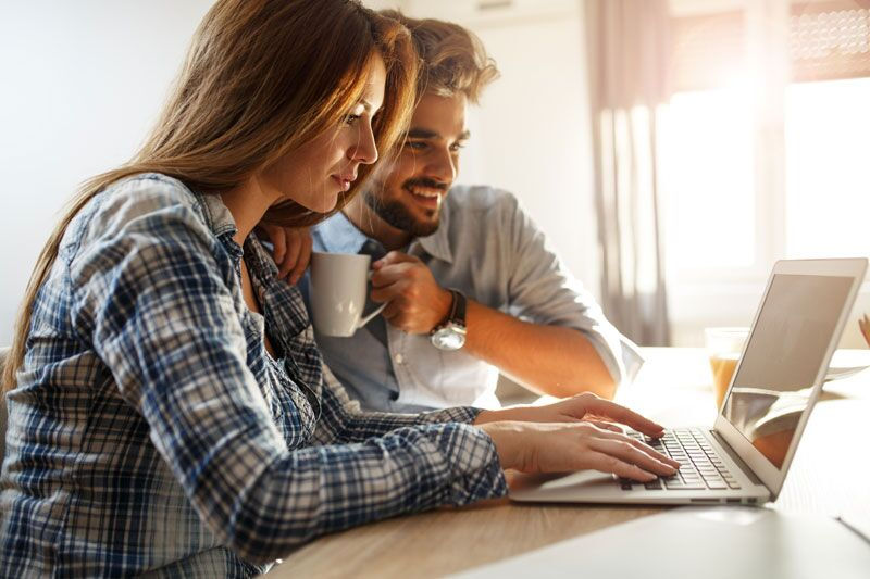 couple looking at life insurance online